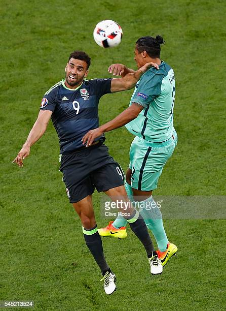 Bruno Alves of Portugal jumps for the ball with Hal RobsonKanu of Wales during the UEFA EURO 2016 semi final match between Portugal and Wales at...