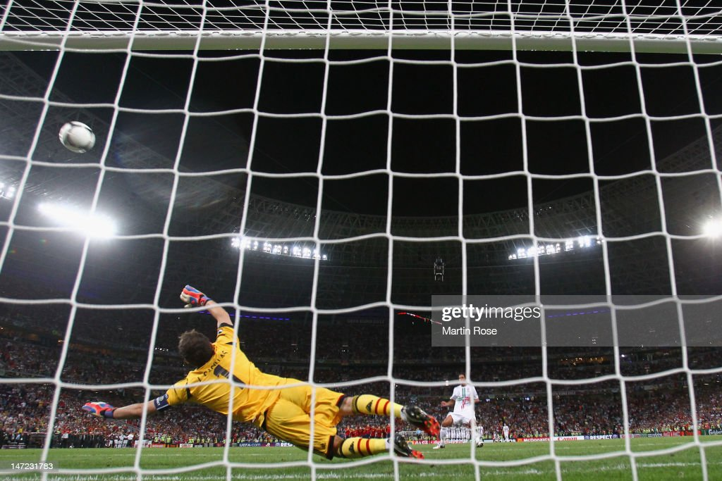 <a gi-track='captionPersonalityLinkClicked' href=/galleries/search?phrase=Bruno+Alves&family=editorial&specificpeople=2149132 ng-click='$event.stopPropagation()'>Bruno Alves</a> of Portugal misses a penalty during the UEFA EURO 2012 semi final match between Portugal and Spain at Donbass Arena on June 27, 2012 in Donetsk, Ukraine.