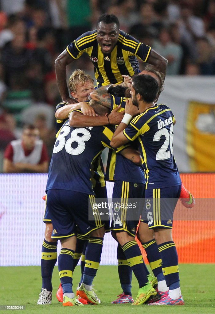 <a gi-track='captionPersonalityLinkClicked' href=/galleries/search?phrase=Bruno+Alves&family=editorial&specificpeople=2149132 ng-click='$event.stopPropagation()'>Bruno Alves</a> (C) with his teammates of Fenerbahce SK celebrates after scoring the first team's goal during the pre-season friendly match between AS Roma and Fenerbahce SK at Stadio Olimpico on August 19, 2014 in Rome, Italy.