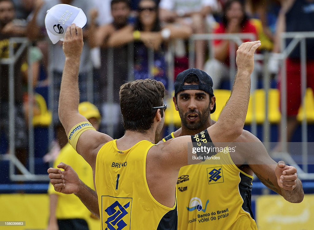 Bruno and Pedro celebrates a victory and the title during a beach volleyball match against the 6th stage of the season 2012/2013 Circuit Bank of Brazil at Copacabana Beach on December 09, 2012 in Rio de Janeiro, Brazil.
