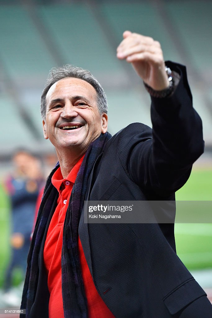 Bruno Bini head coach of China celebrates his team's 1-0 win in the AFC Women's Olympic Final Qualification Round match between China and South Korea at Yanmar Stadium Nagai on March 7, 2016 in Osaka, Japan.