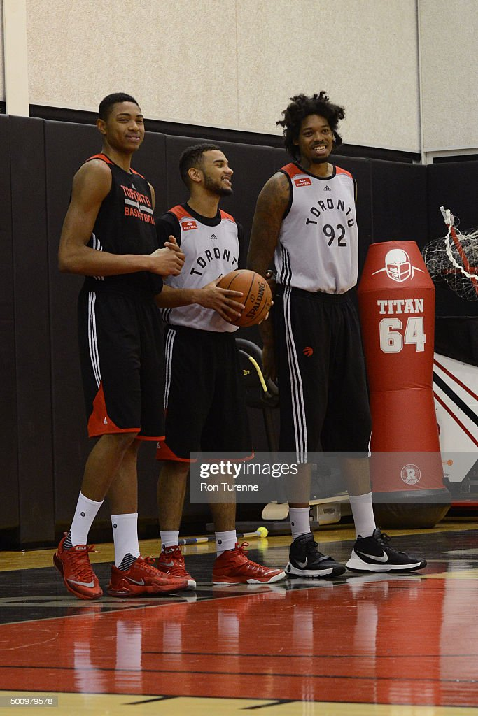 <a gi-track='captionPersonalityLinkClicked' href=/galleries/search?phrase=Bruno+Caboclo&family=editorial&specificpeople=12933791 ng-click='$event.stopPropagation()'>Bruno Caboclo</a> #20, <a gi-track='captionPersonalityLinkClicked' href=/galleries/search?phrase=Cory+Joseph&family=editorial&specificpeople=5953537 ng-click='$event.stopPropagation()'>Cory Joseph</a> #6 and <a gi-track='captionPersonalityLinkClicked' href=/galleries/search?phrase=Lucas+Nogueira&family=editorial&specificpeople=11015607 ng-click='$event.stopPropagation()'>Lucas Nogueira</a> #92 of the Toronto Raptors smiles and looks on during open practice on December 6, 2015 at the Air Canada Centre in Toronto, Ontario, Canada.