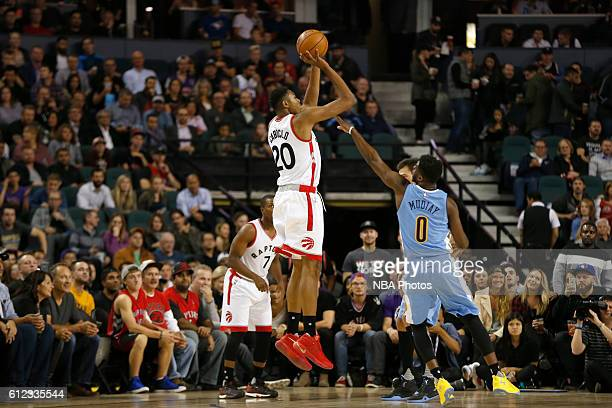 Bruno Caboclo of the Toronto Raptors shoots the ball against the Denver Nuggets on October 3 2016 at the Scotiabank Saddledome in Calagary Alberta...