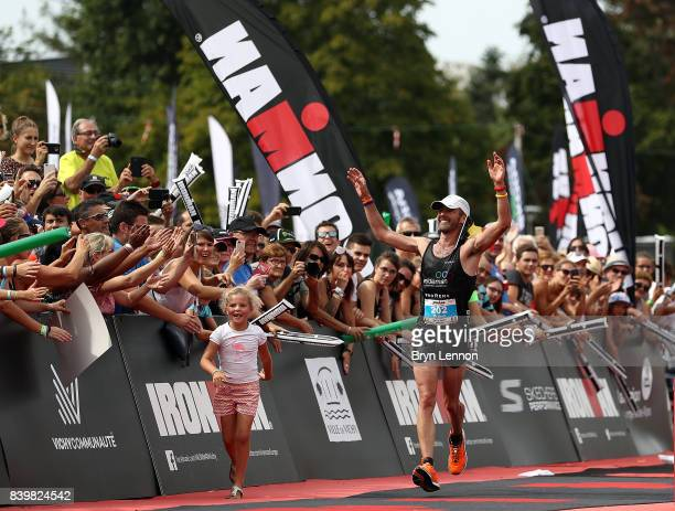 Bruno Clerbout of Belgium celebrates winning the IRONMAN Vichy on August 27 2017 in Vichy France