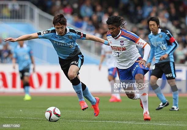 Bruno Cortes of Albirex Niigata and Kenyu Sugimoto of Kawasaki Frontale compete for the ball during the JLeague match between Kawasaki Frontale and...