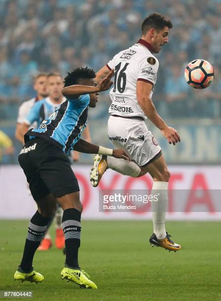 Bruno Cortez of Gremio struggles for the ball with Alejandro Silva Gonzalez of Lanus during a first leg match between Gremio and Lanus as part of...