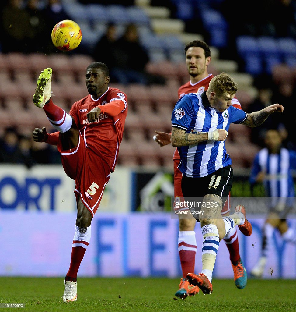<a gi-track='captionPersonalityLinkClicked' href=/galleries/search?phrase=Bruno+Ecuele+Manga&family=editorial&specificpeople=7115761 ng-click='$event.stopPropagation()'>Bruno Ecuele Manga</a> of Cardiff City clears the ball <a gi-track='captionPersonalityLinkClicked' href=/galleries/search?phrase=James+McClean&family=editorial&specificpeople=3699424 ng-click='$event.stopPropagation()'>James McClean</a> of Wigan Athletic during the Sky Bet Championship match between Wigan Athletic and Cardiff City at DW Stadium on February 24, 2015 in Wigan, England.