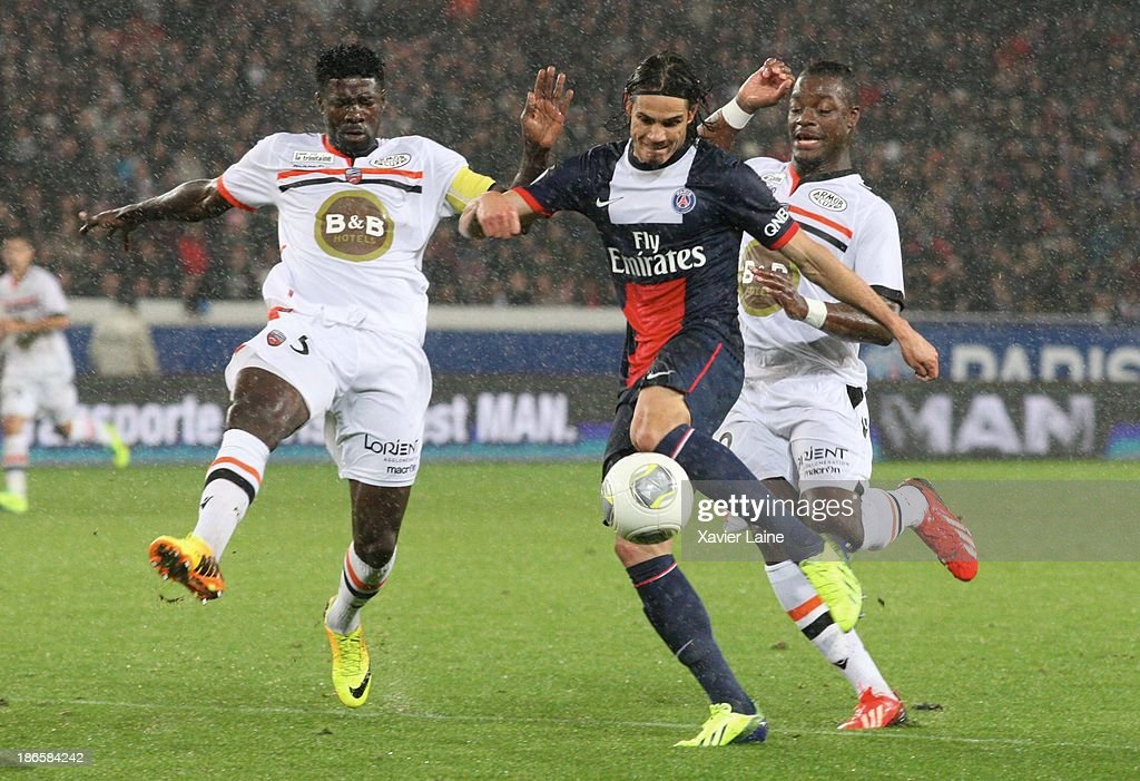 Bruno Ecuele-Manga (L), Lamine Kone of Lorient FC and <a gi-track='captionPersonalityLinkClicked' href=/galleries/search?phrase=Edinson+Cavani&family=editorial&specificpeople=4104253 ng-click='$event.stopPropagation()'>Edinson Cavani</a> of Paris Saint-Germain during the French League 1 between Paris Saint-Germain FC and Lorient FC, at Parc des Princes on November 1, 2013 in Paris, France.