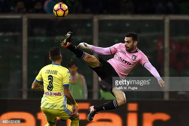 Bruno Enrique of Palermo jumps for the ball as Cristiano Biraghi of Pescara tackles during the Serie A match between US Citta di Palermo and Pescara...