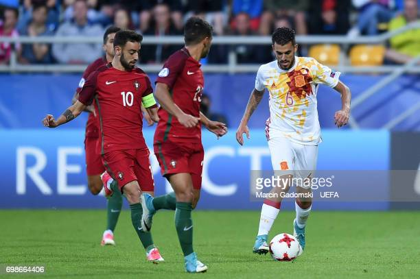 Bruno Fernandes and Joao Carvalho of Portugal and Dani Ceballos of Spain during their UEFA European Under21 Championship match on June 20 2017 in...
