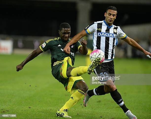 Bruno Fernandes Borges of Udinese Calcio competes with Cristian Zapata of AC Milan during the Serie A match between Udinese Calcio and AC Milan at...