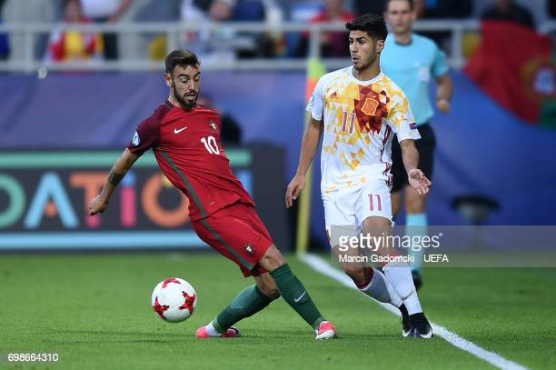 Bruno Fernandes of Portugal and Marco Asensio of Spain during their UEFA European Under21 Championship match on June 20 2017 in Gdynia Poland