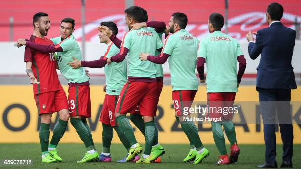 Bruno Fernandes of Portugal celebrates with his team mates after scoring a goal to make it 01 during the U21 International Friendly match between...