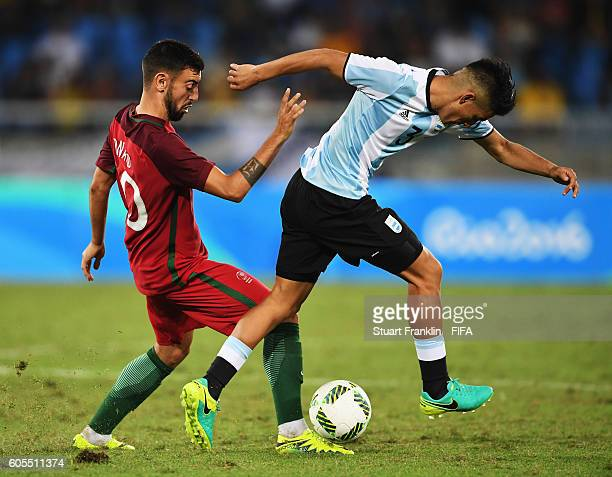 Bruno Fernandes of Portugal is challenged by Alexis Soto of Argentina during the Olympic Men's Football match between Portugal and Argentina at...