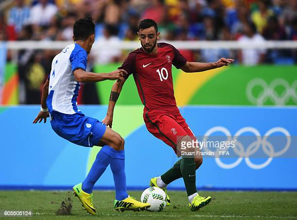 Bruno Fernandes of Portugal is challenged by Bryan Acosta of Honduras during the Olympic Men's Football match between Honduras and Portugal at...