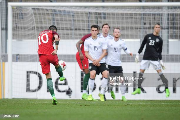 Bruno Fernandes of Portugal scores his team's first goal to make it 01 during the U21 International Friendly match between Germany U21 and Portugal...