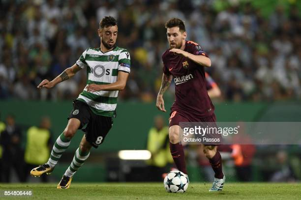 Bruno Fernandes of Sporting CP competes for the ball with Lionel Messi of FC Barcelona during the UEFA Champions League group D match between...