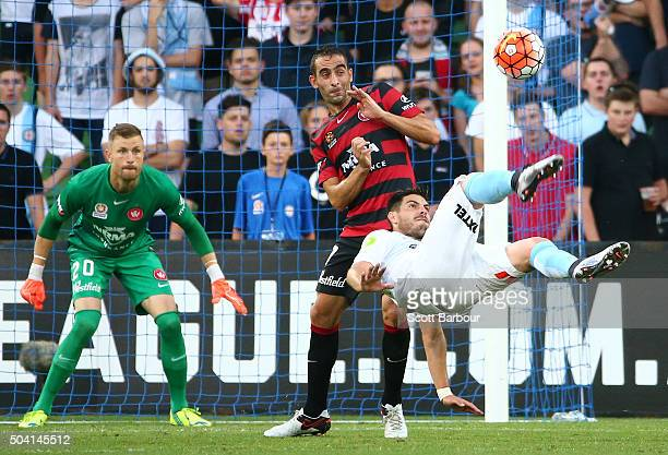 Bruno Fornaroli of City FC attempts a shot on goal with an overhead scissor kick as goalkeeper Dean Bouzanis of City FC looks on during the round 14...