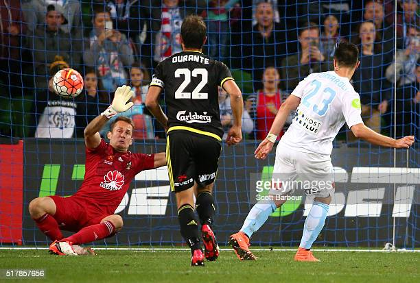 Bruno Fornaroli of City FC beats goalkeeper Glen Moss of the Phoenix to score the second goal during the round 25 ALeague match between Melbourne...
