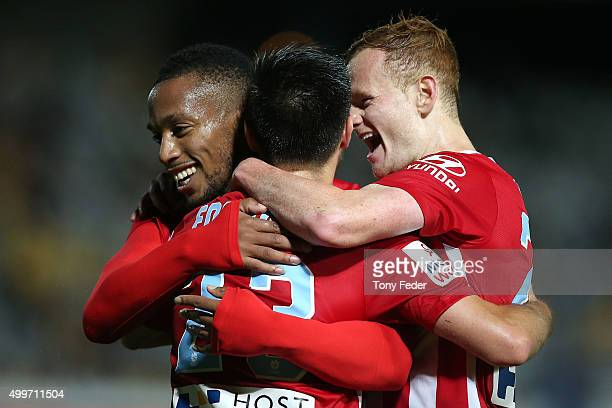 Bruno Fornaroli of Melbourne City celebrates a goal with team mates during the round nine ALeague match between the Central Coast Mariners and...