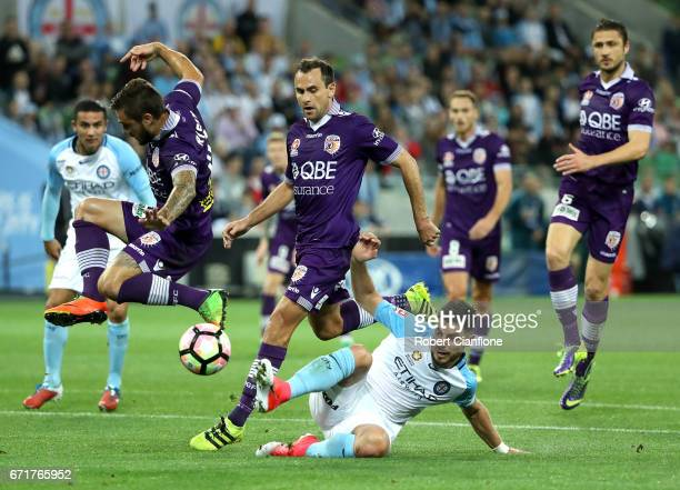 Bruno Fornaroli of Melbourne City is challenged by Josh Risdon of Perth Glory during the ALeague Elimination Final match between Melbourne City FC...