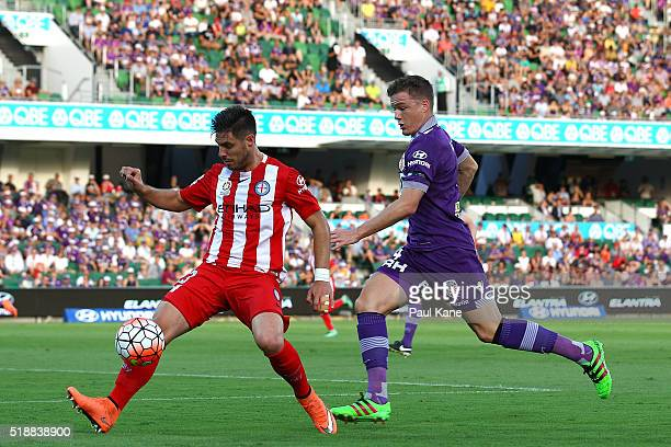 Bruno Fornaroli of Melbourne controls the ball against Shane Lowry of the Glory during the round 26 ALeague match between the Perth Glory and...