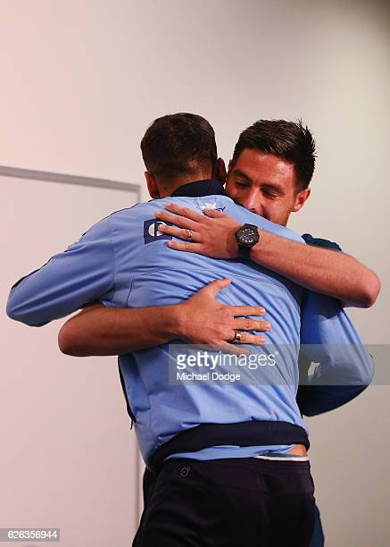Bruno Fornaroli of the City and Alex Brosque of Sydney FC hug before a press conference ahead of the FFA Cup Final at AAMI Park on November 29 2016...