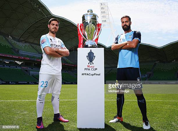 Bruno Fornaroli of the City and Alex Brosque of Sydney FC pose with the FFA Cup during a press conference ahead of the FFA Cup Final at AAMI Park on...