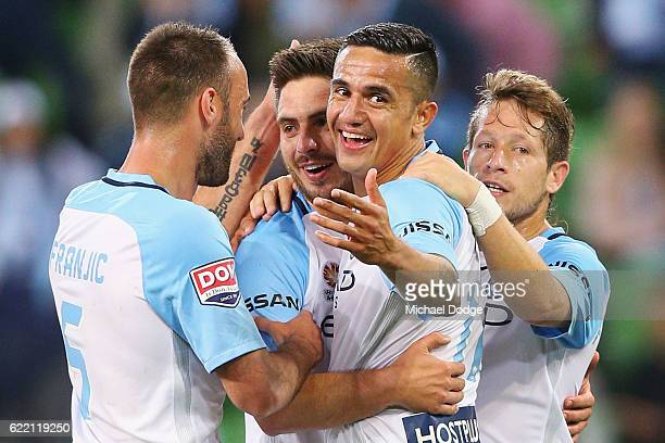 Bruno Fornaroli of the City celebrates a goal with Tim Cahill during the round six ALeague match between Melbourne City FC and Newcastle Jets at AAMI...