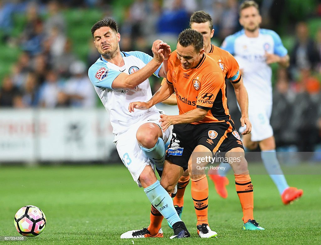 Bruno Fornaroli of the City collides with Jade North of Brisbane Roar as they compete for the ball during the round nine A-League match between Melbourne City FC and the Brisbane Roar at AAMI Park on December 3, 2016 in Melbourne, Australia.