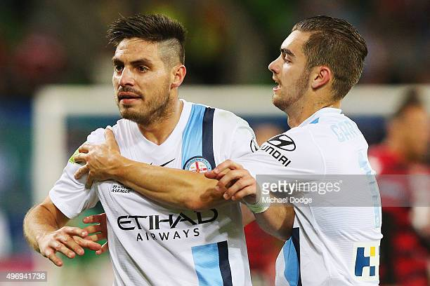 Bruno Fornaroli of the City is held back by teamate Ben Garuccio after a goal Frederico Piovaccari of the Wanderers was allowed during the round six...