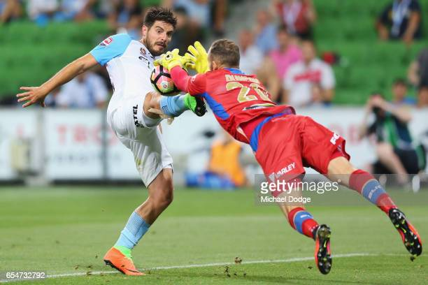 Bruno Fornaroli of the City kicks the ball at goal against Jets Keeper Jack Duncan during the round 23 ALeague match between Melbourne City FC and...