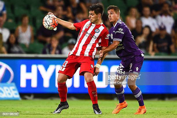 Bruno Fornaroli of the Melbourne City FC holds the ball up in front of Jacob Collard of the Perth Glory during the round 15 ALeague match between...