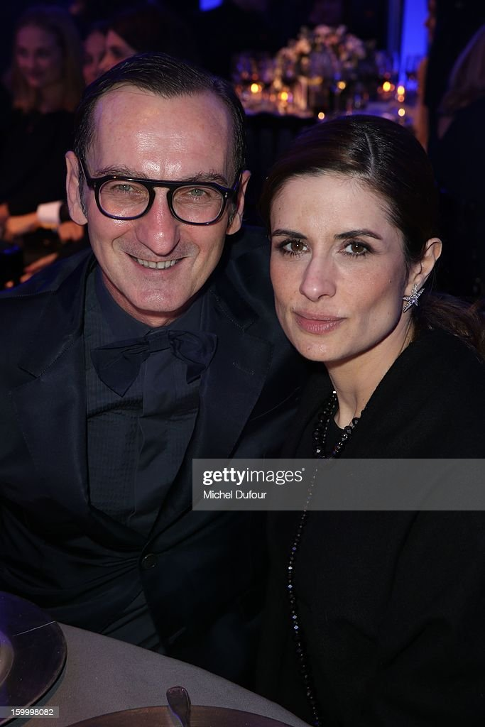 Bruno Frisoni and Livia Firth attend the Sidaction Gala Dinner 2013 at Pavillon d'Armenonville on January 24, 2013 in Paris, France.