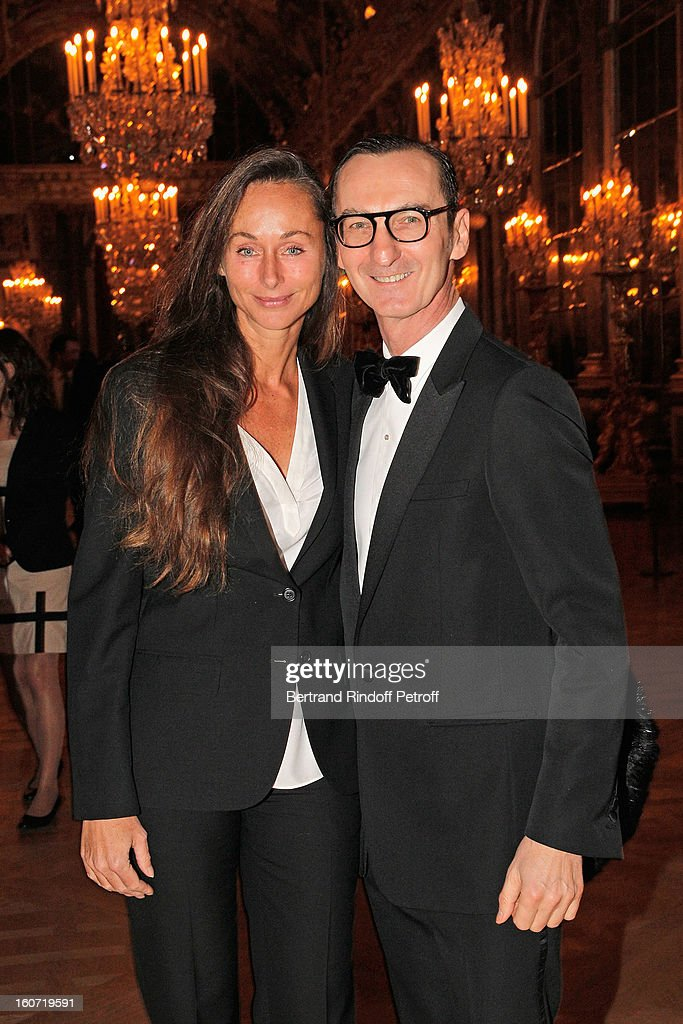 Bruno Frisoni (R) and Marianne Orlowski pose in the Hall of Mirrors as they attend the gala dinner of Professor David Khayat's association 'AVEC', at Chateau de Versailles on February 4, 2013 in Versailles, France.