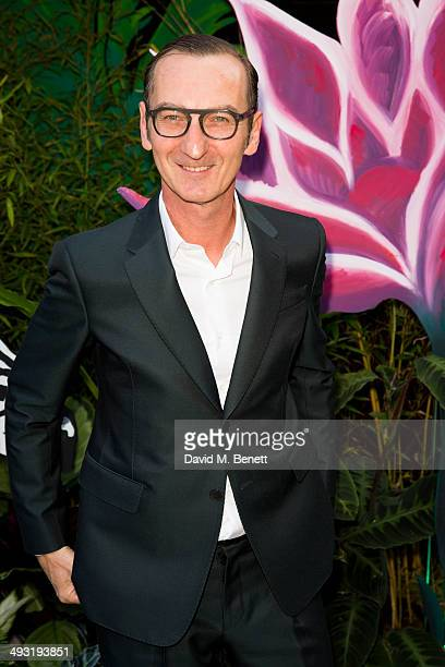 Bruno Frisoni arrives at Roger Vivier Summer Party at Loulou's on May 22 2014 in London England