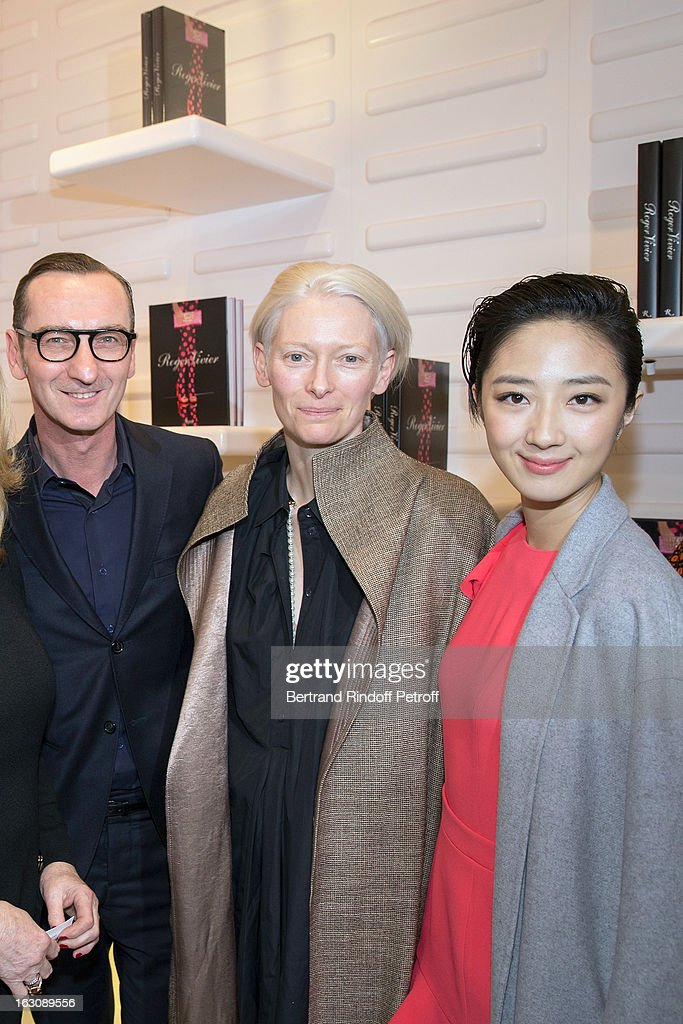 Bruno Frisoni, <a gi-track='captionPersonalityLinkClicked' href=/galleries/search?phrase=Tilda+Swinton&family=editorial&specificpeople=202991 ng-click='$event.stopPropagation()'>Tilda Swinton</a> and Kwai Lun-mei attend the Roger Vivier Cocktail, to celebrate the launch of the book 'Roger Vivier', as part of Paris Fashion Week on March 4, 2013 in Paris, France.
