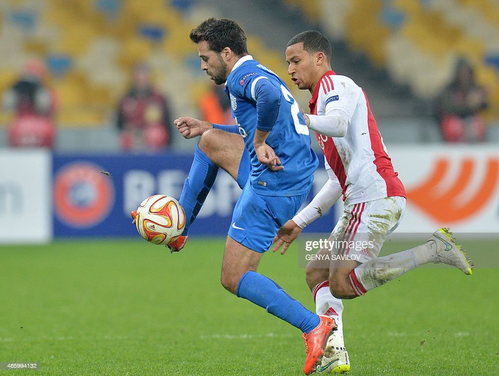 <a gi-track='captionPersonalityLinkClicked' href=/galleries/search?phrase=Bruno+Gama&family=editorial&specificpeople=2251634 ng-click='$event.stopPropagation()'>Bruno Gama</a> (L) of FC Dnipro Dnipropetrovsk clears the ball past Ajax's <a gi-track='captionPersonalityLinkClicked' href=/galleries/search?phrase=Ricardo+van+Rhijn&family=editorial&specificpeople=4508816 ng-click='$event.stopPropagation()'>Ricardo van Rhijn</a> (R) during the Europa League Round of 16 match between Dnipro Dnipropetrovsk and Ajax Amsterdam in Kiev on March 12, 2015.