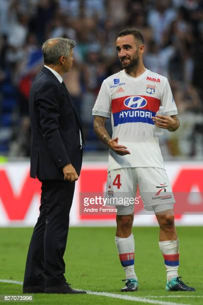 Bruno Genesio coach of Lyon and Sergi Darder Moll of Lyon during the Ligue 1 match between Olympique Lyonnais and Strasbourg at Parc Olympique on...