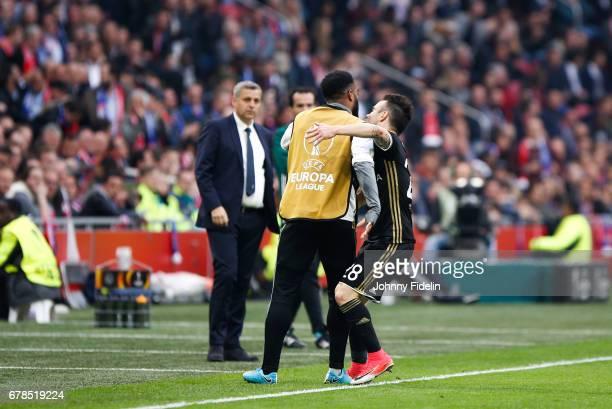 Bruno Genesio looks Alexandre Lacazette and Mathieu Valbuena of Lyon celebrate his goal during the Uefa Europa League semi final first leg match...