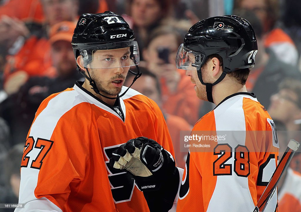 Bruno Gervais #27 and Claude Giroux #28 of the Philadelphia Flyers share a few words during a stoppage in play against the Carolina Hurricanes on February 9, 2013 at the Wells Fargo Center in Philadelphia, Pennsylvania.