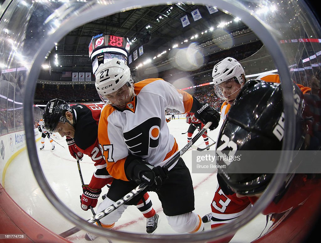 <a gi-track='captionPersonalityLinkClicked' href=/galleries/search?phrase=Bruno+Gervais&family=editorial&specificpeople=215079 ng-click='$event.stopPropagation()'>Bruno Gervais</a> #27 of the Philadelphia Flyers battles the New Jersey Devils along the boards at the Prudential Center on February 15, 2013 in Newark, New Jersey. The Devils defeated the Flyers 5-3.