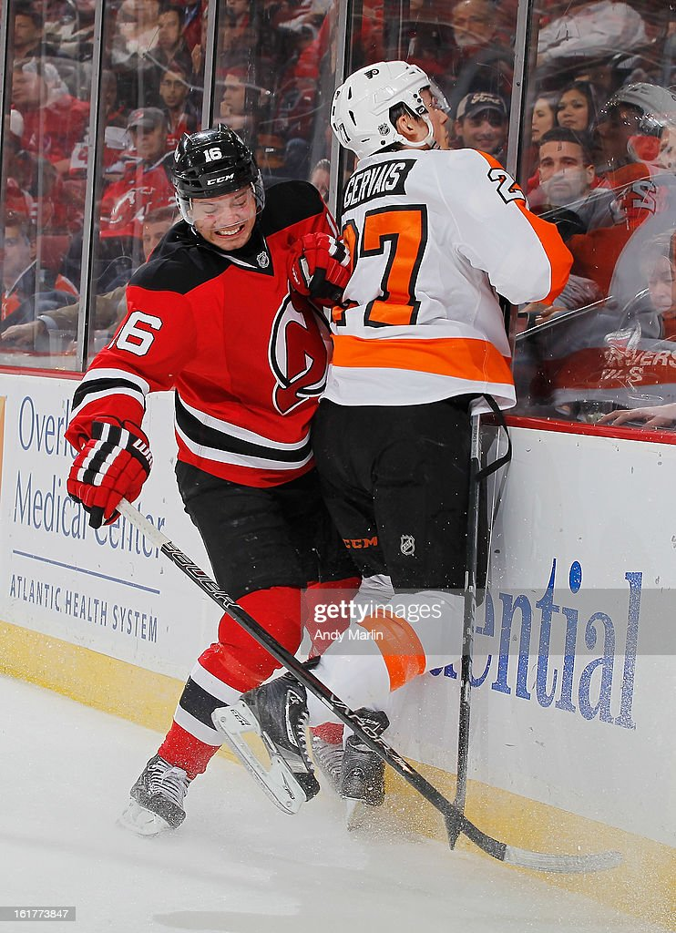Bruno Gervais #27 of the Philadelphia Flyers is checked into the boards by Jacob Josefson #16 of the New Jersey Devils during the game at the Prudential Center on February 15, 2013 in Newark, New Jersey.