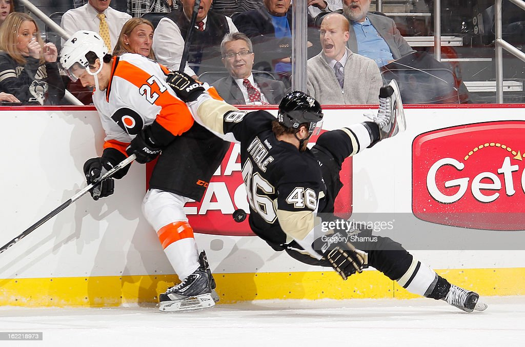 Bruno Gervais #27 of the Philadelphia Flyers trips up Joe Vitale #46 of the Pittsburgh Penguins while battling for the puck on February 20, 2013 at Consol Energy Center in Pittsburgh, Pennsylvania.
