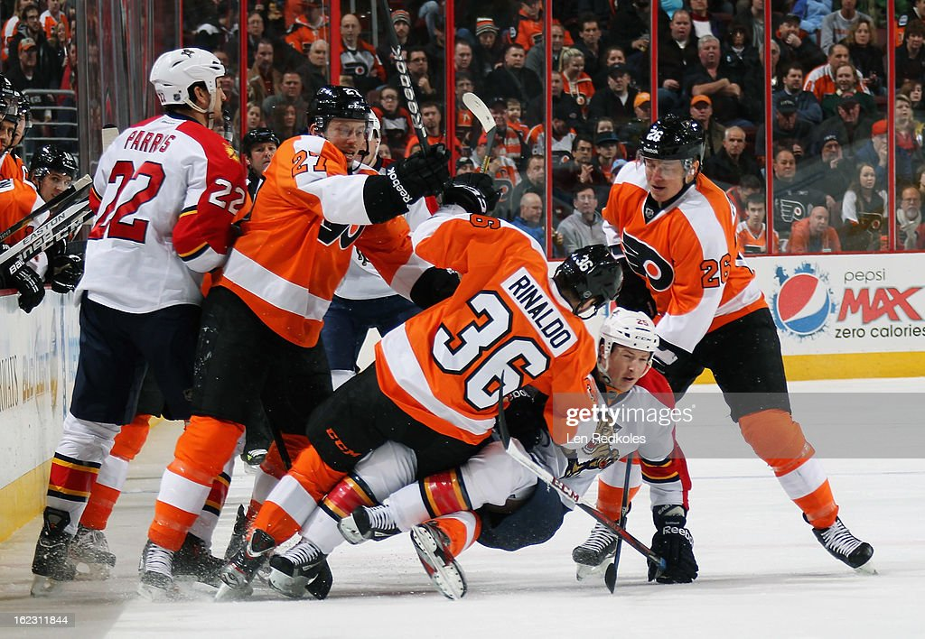 Bruno Gervais #27, Zac Rinaldo #36, and Ruslan Fedotenko #26 of the Philadelphia Flyers are in the midst of a scrum with George Parros #22 and Tyson Strachan #23 of the Florida Panthers on February 21, 2013 at the Wells Fargo Center in Philadelphia, Pennsylvania.