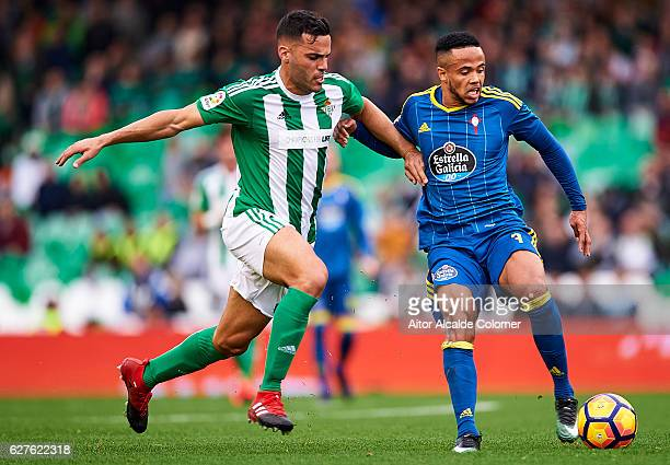 Bruno Gonzalez of Real Betis Balompie competes for the ball with Theo Bongonda of RC Celta de Vigo during La Liga match between Real Betis Balompie...