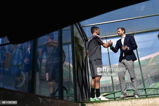 Bruno Henrique and Paul Baccaglini President of US Citta' di Palermo speak during a training session at Renzo Barbera Stadium on March 30 2017 in...