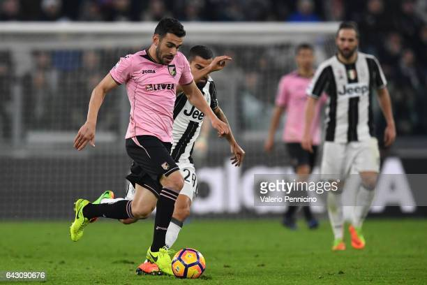 Bruno Henrique Corsini of US Citta di Palermo in action against Tomas Rincon of Juventus FC during the Serie A match between Juventus FC and US Citta...