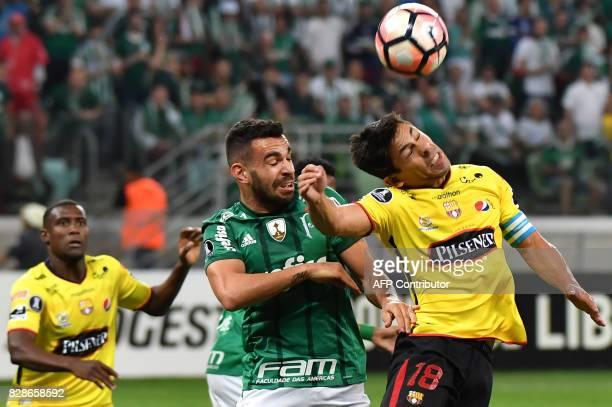 Bruno Henrique of Brazil's Palmeiras vies for the ball with Matias Oyola of Ecuador's Barcelona during their 2017 Copa Libertadores football match...