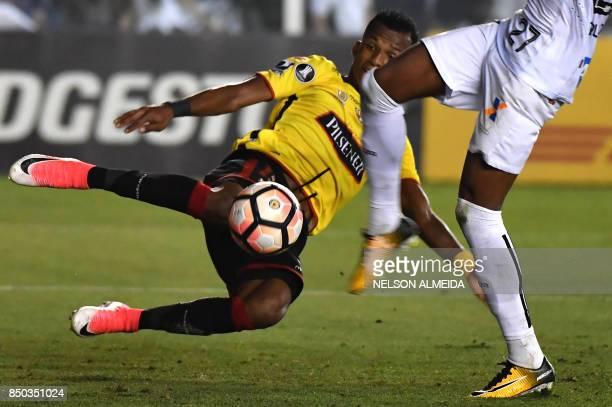Bruno Henrique of Brazils Santos vies for the ball with Dario Aimar of Ecuador's Barcelona during their 2017 Copa Libertadores quarterfinal second...
